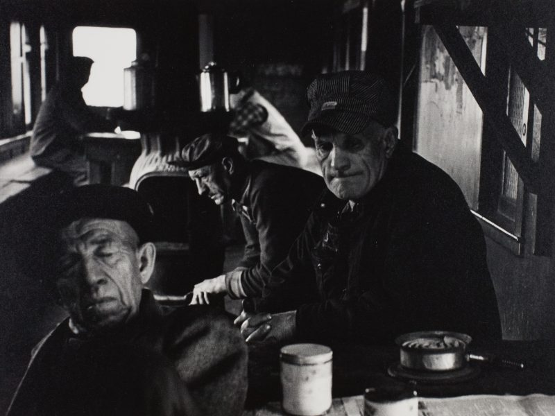 Simpson Kalisher, A Yard Crew Keeps Warm and Waits Between Jobs in a Converted Car in the Yard, c. 1957