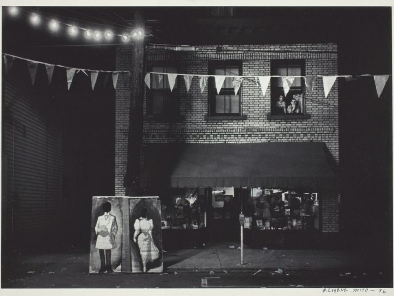W. Eugene Smith, Untitled [night view, store front with pennants], 1955/56